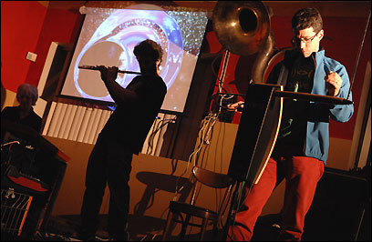 Jon Bernhardt (right, performing with the Lothars) plays the theremin for a new White Castle Commercial. (Wiqan Ang for the Boston Globe)